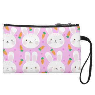 Cute cartoon bunnies and carrots on pink pattern wristlet