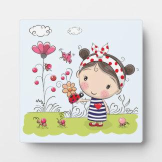 Cute Cartoon Girl with Ladybug in Garden Scene Plaque