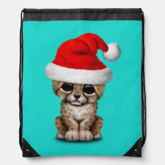 Cute Cheetah Cub Wearing a Santa Hat Drawstring Bag