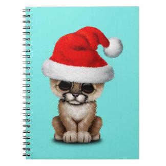 Cute Cougar Cub Wearing a Santa Hat Notebooks
