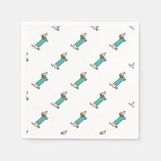 Cute dachshund in mint blue paper napkins