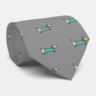Cute dachshund in mint blue tie