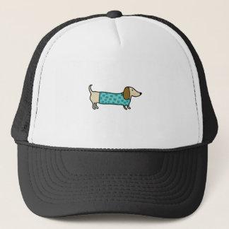 Cute dachshund in mint blue trucker hat