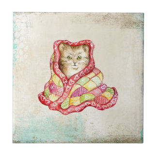 Cute domestic kitten with a red adorable blanket tile