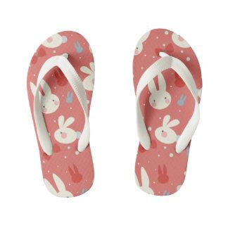 Cute easter bunnies on red background pattern kid's flip flops