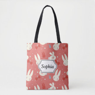 Cute easter bunnies on red background pattern tote bag