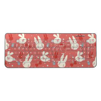 Cute easter bunnies on red background pattern wireless keyboard