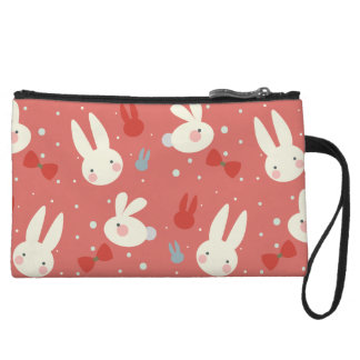 Cute easter bunnies on red background pattern wristlet