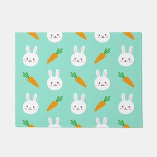 Cute easter bunny and carrots on aqua pattern doormat