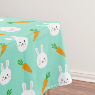 Cute easter bunny and carrots on aqua pattern tablecloth