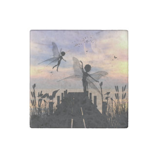 Cute fairy dancing on a jetty stone magnets