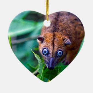 Cute furry cuscus possum looking at camera ceramic heart ornament
