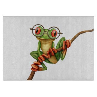 Cute Green Tree Frog with Eye Glasses on White Cutting Board