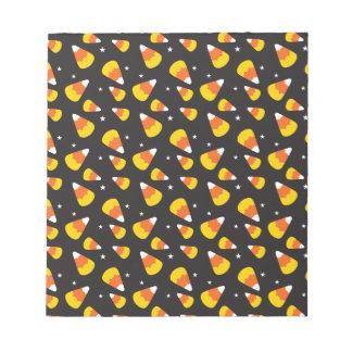Cute Halloween candy corn on black pattern Notepads