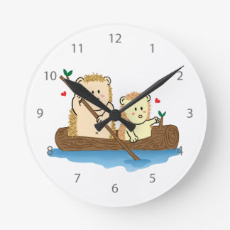 Cute Hedgehog couple sailing on wooden boat Round Clock