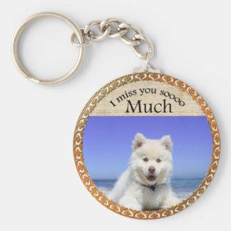 Cute Husky's with blue eye sitting on the beach Keychain