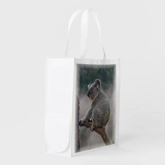 Cute koala bear on a eucalyptus tree grocery bag