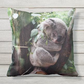 Cute Koala Bear relaxing in a Tree Outdoor Pillow