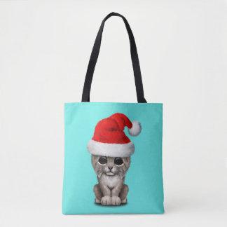 Cute Lynx Cub Wearing a Santa Hat Tote Bag