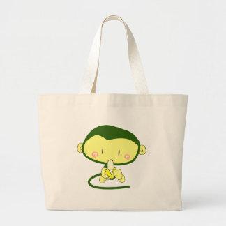 Cute Monkey Eating a Banana Canvas Bags