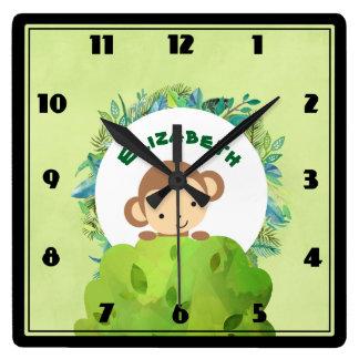 Cute Monkey Peeking Out from Behind a Bush Clock