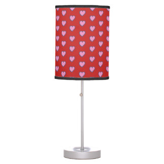 Cute pink hearts on red table lamp