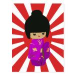 Cute Pink  Kokeshi Doll on rising sun