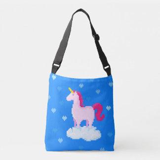 Cute pink unicorn stands on a cloud crossbody bag