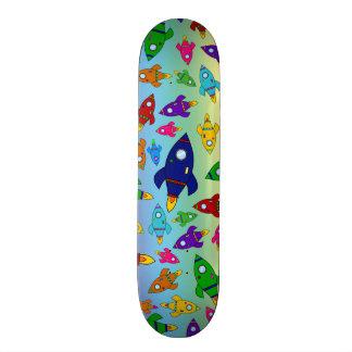 Cute rainbow rocket ships pattern skateboard deck