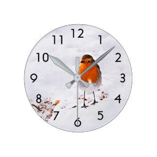 Cute Robin bird in snow Clocks