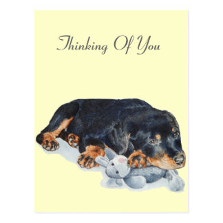 cute rottweiler puppy dog cuddling teddy bear art postcard