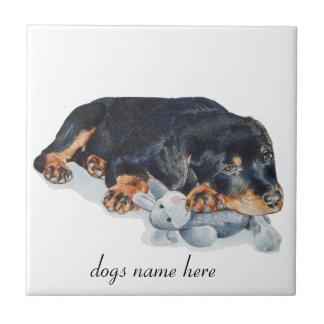 cute rottweiler puppy dog cuddling teddy bear art tile