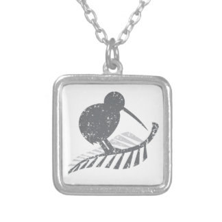 cute silver kiwi bird and silver fern distressed silver plated necklace