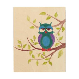 Cute sleepy owl on a tree cartoon Wood print
