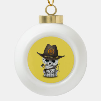 Cute Snow Leopard Cub Zombie Hunter Ceramic Ball Christmas Ornament