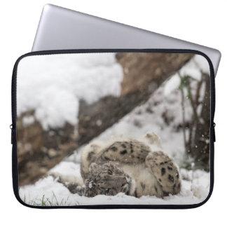 Cute Snow Leopard Plays in Snow Laptop Sleeve