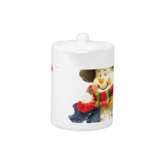 Cute snowman figurine with red berries on white