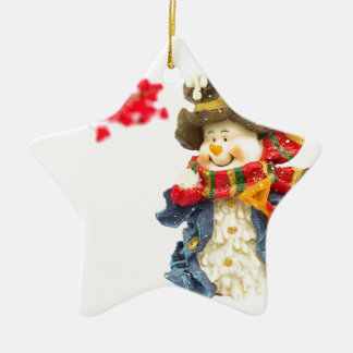 Cute snowman figurine with red berries on white ceramic star ornament
