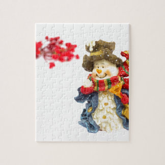 Cute snowman figurine with red berries on white jigsaw puzzle