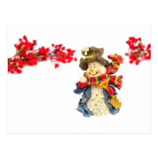 Cute snowman figurine with red berries on white postcard