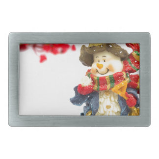 Cute snowman figurine with red berries on white rectangular belt buckle
