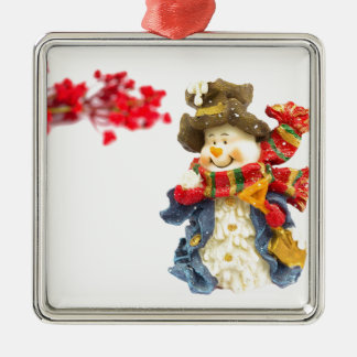 Cute snowman figurine with red berries on white Silver-Colored square ornament