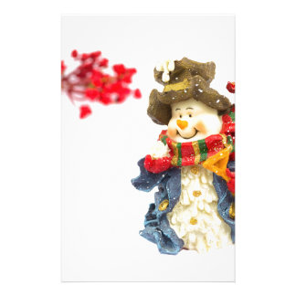 Cute snowman figurine with red berries on white stationery