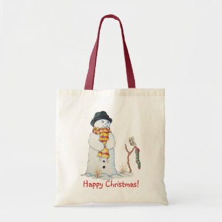 Cute snowman with Christmas stocking in the snow Tote Bag