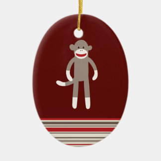 Cute Sock Monkey on Red with Stripes Ceramic Oval Ornament