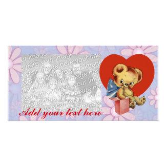Cute Valentine Bear on pink flowered background Card