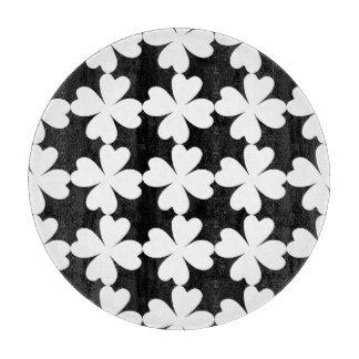 Cute white shamrocks on black cutting board
