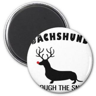 dachshund through the snow 2 inch round magnet