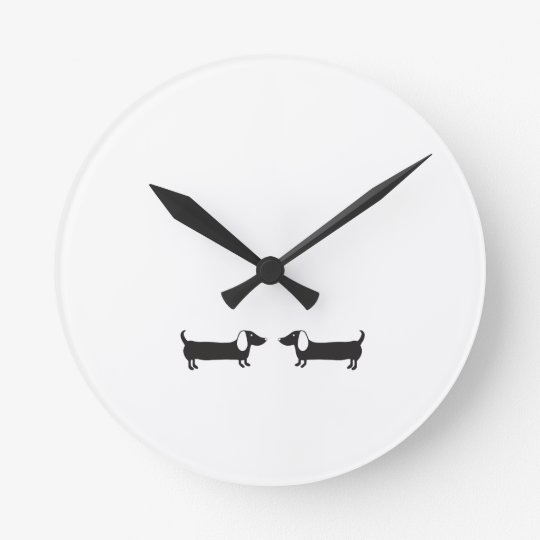 Dachshunds in black and white love round clock