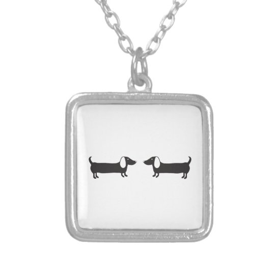 Dachshunds in black and white love silver plated necklace